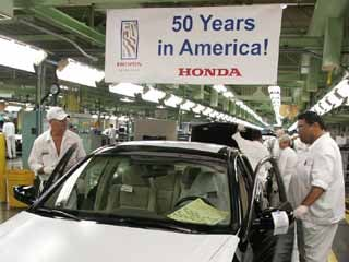 Associates at Honda's first U.S. auto plant in Marysville, Ohio, assemble vehicles on the 50th anniversary of the establishment of American Honda Motor Co. on June 11, 1959. (©Honda)