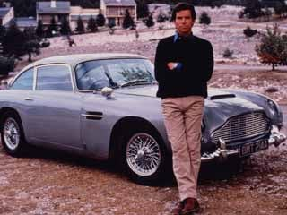 Pierce Brosnan with the Aston Martin DB5 from Tomorrow Never Dies. (&amp;copy;Aston Martin)