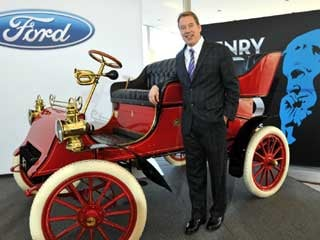 Bill Ford with the 1903 Model A. (© Sam VarnHagen/Ford Motor Co.)