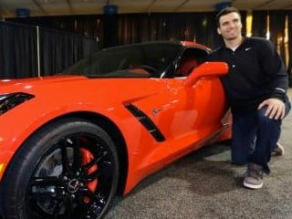 Baltimore Ravens Quarterback Joe Flacco receives a 2014 Chevrolet Corvette Stingray on Monday, February 4, after being named Super Bowl XLVII MVP in New Orleans. (© General Motors/Photo by AJ Mast for Chevrolet)